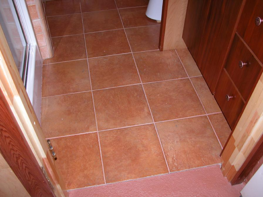 Italian Terra Cotta Style Ceramic Tile On Floor Around Basin And