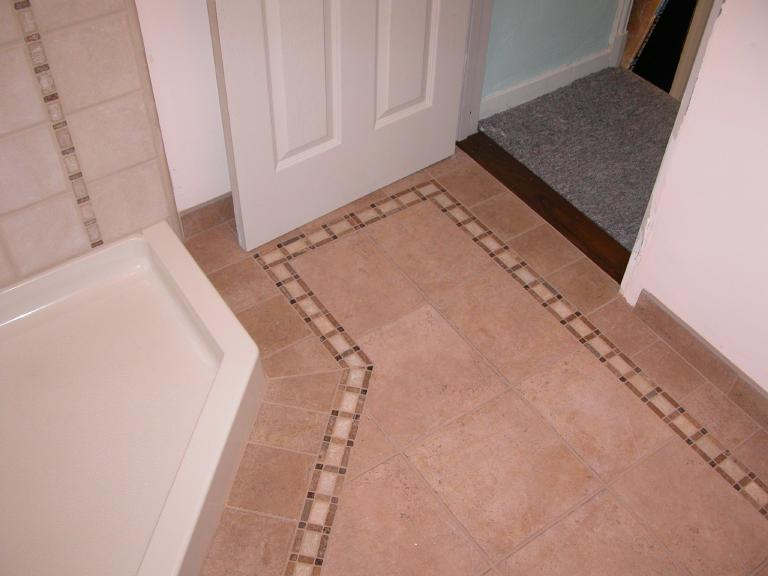 """Bathroom floor, 12x12 ceramic field with border including 3"""" natural stone mosaic"""