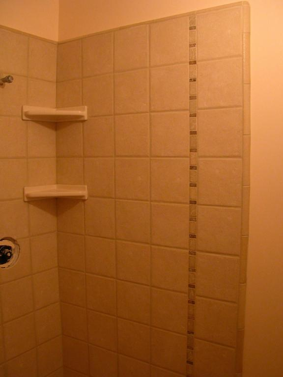Shower stall 8x8 ceramic tile with stone accent strip